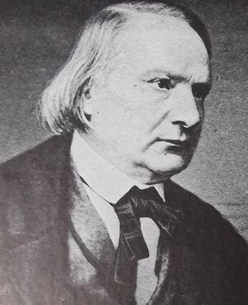 Portrait photographique de Victor Hugo, en 1860, le visage légèrement bouffi, les yeux sombres.