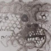 Ce détail d'un dessin de Victor Hugo représente un visage vu de face et de côté, comme saisi aux rayons X.