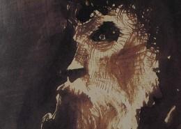 Ce détail d'un dessin de Victor Hugo représente le visage tourmenté d'un homme barbu.