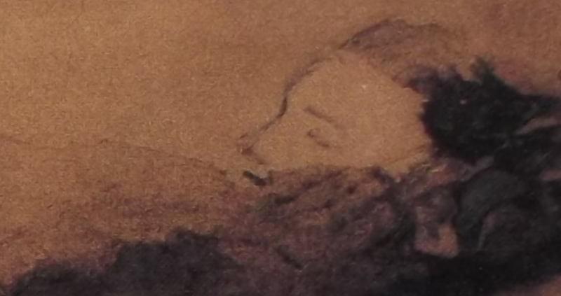 Ce détail d'un dessin de Victor Hugo représente le visage diaphane d'une femme endormie.