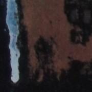 Ce détail d'un dessin de Victor Hugo représente, de façon abstraite, une cicatrice bleue sur une peau ocre sombre.